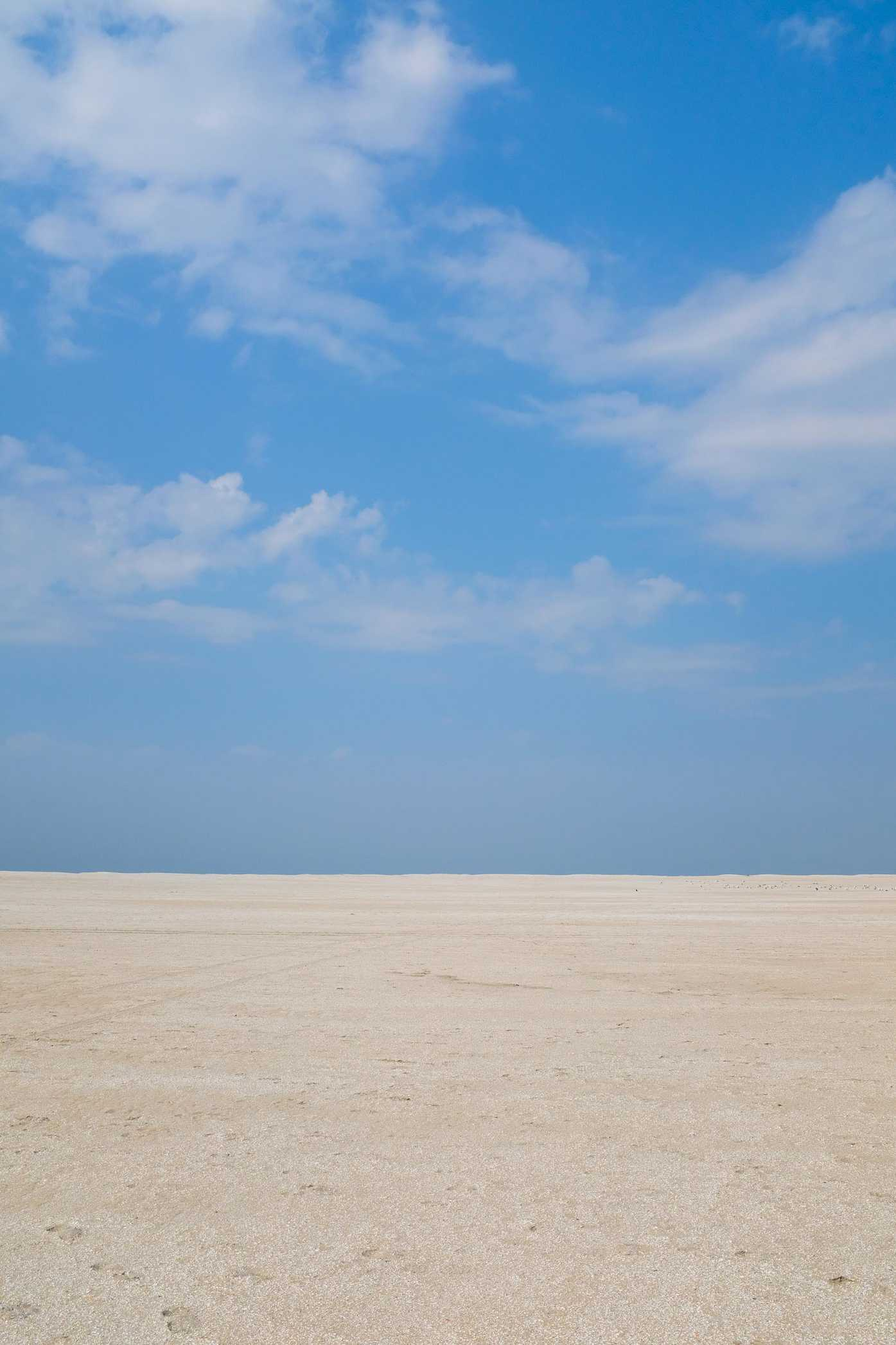 A large expanse of sand and sky