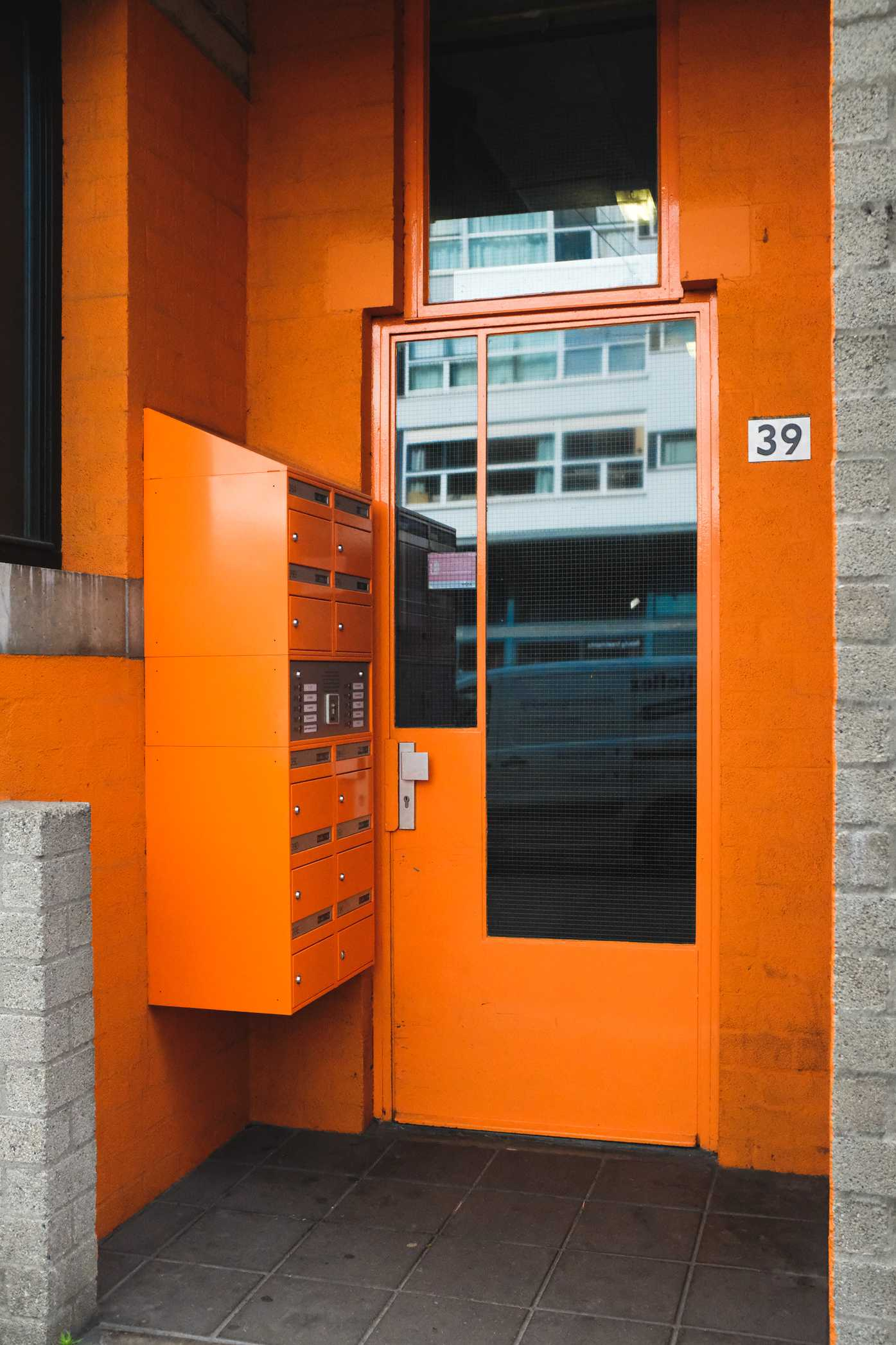 Orange door and mailbox