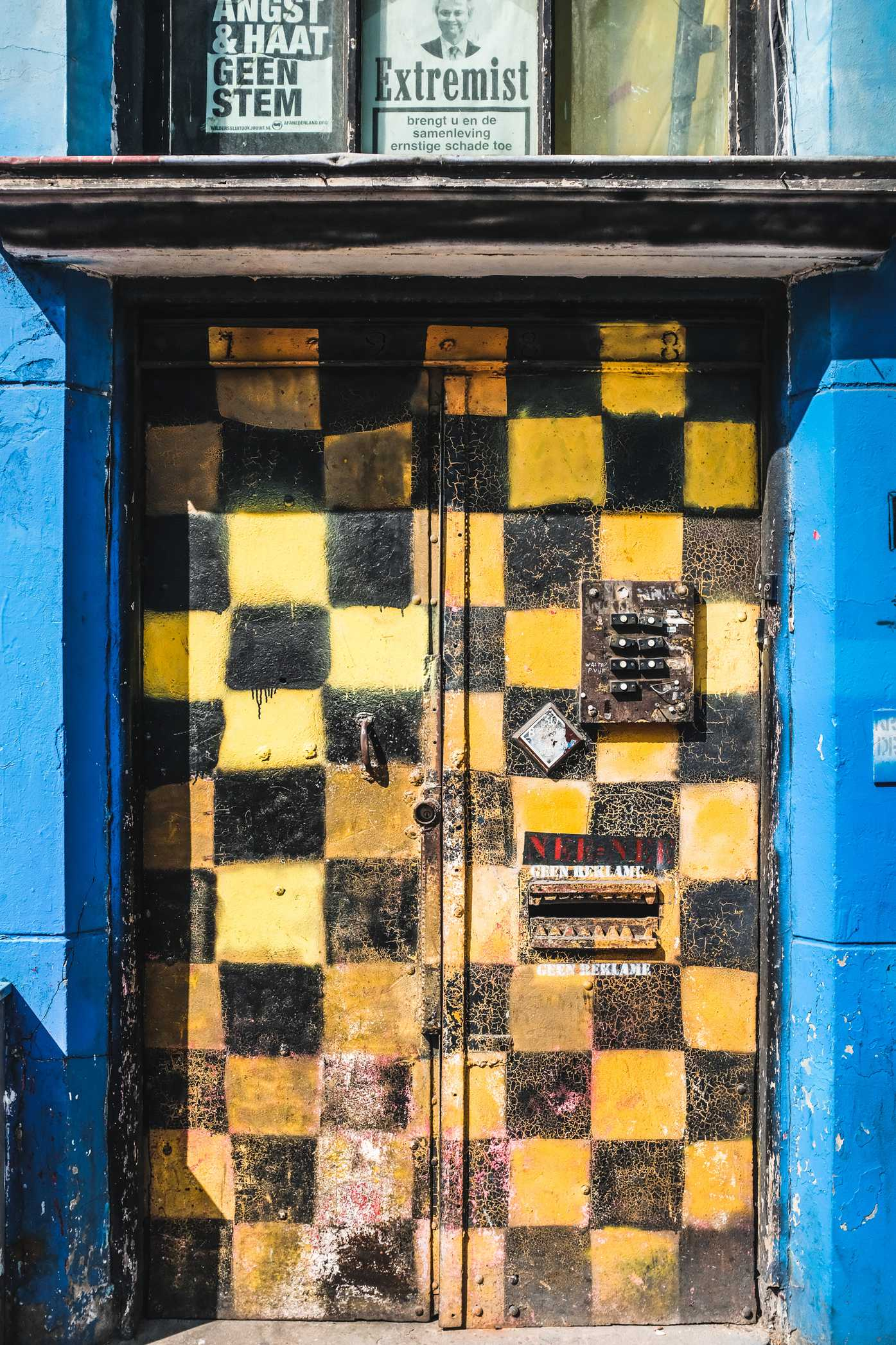 A door with a yellow-and-black checkboard pattern