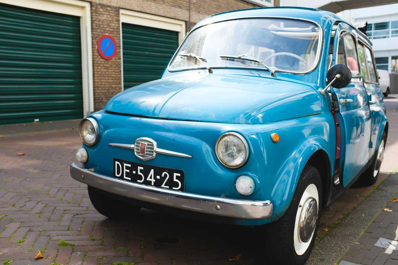 And old blue Fiat car