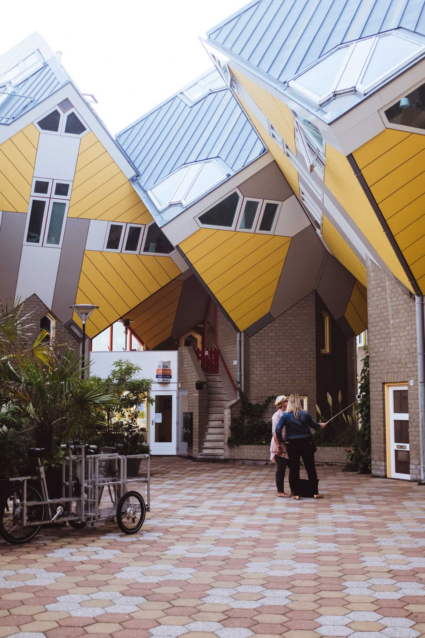 Two women take a selfie in the Cube Houses of Rotterdam