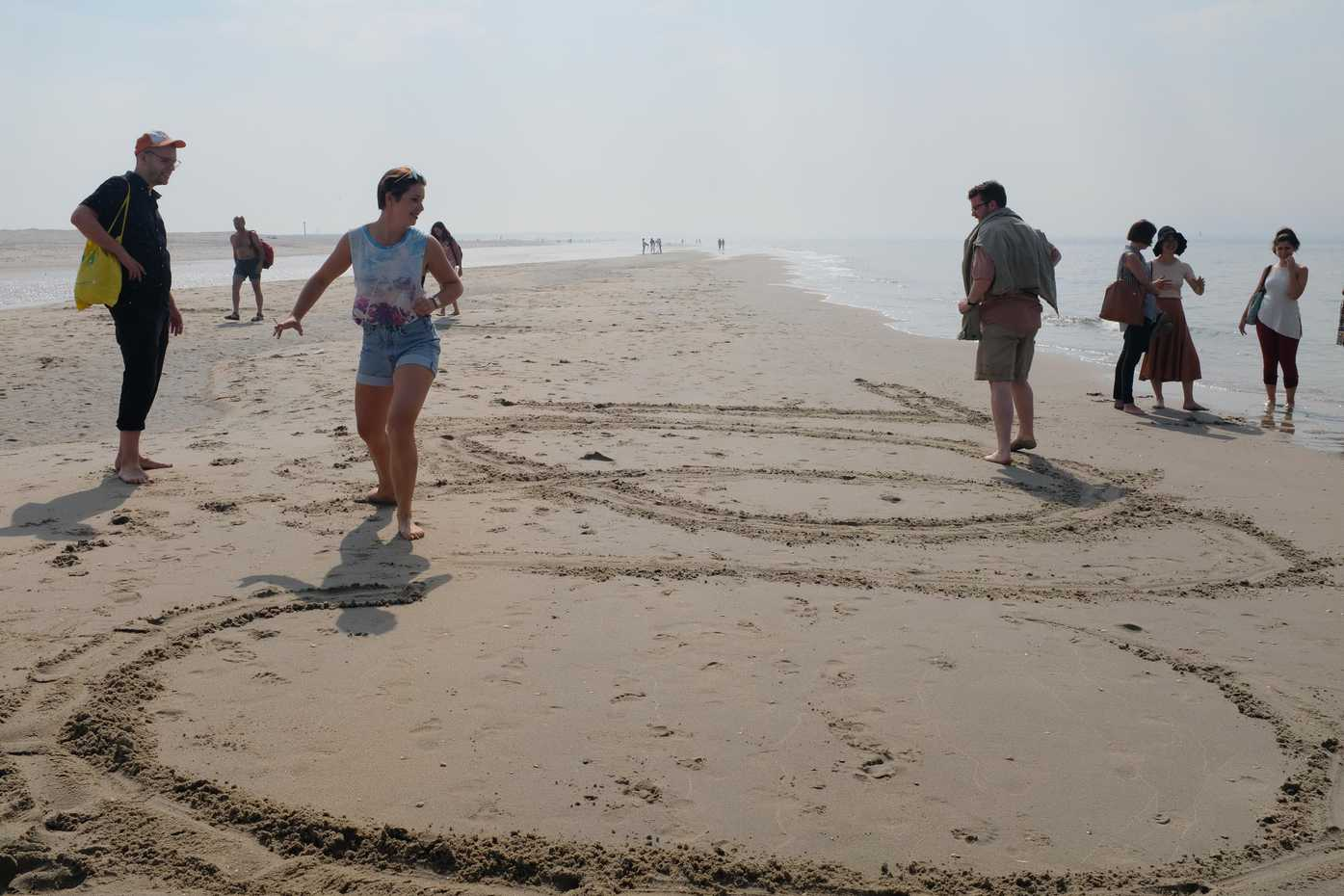 Drawing big letters in the sand. Cool.